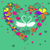 Dvě labutě v Květinové srdce tvarovaný rám — Stock vektor