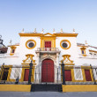 Entrance to the bullfight arena Real Maestranza of Seville (buil — Stock Photo
