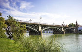 Triana bridge over the river Guadalquivir, Sevilla, Andalusia, S — Stock Photo
