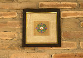 Old wooden picture frame on wall background — Stok fotoğraf