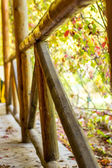 Wooden fence against green bokeh — Stock Photo