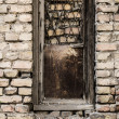 Old dirty window on old dirty wall — Stockfoto