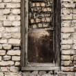 Old dirty window on old dirty wall — 图库照片