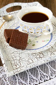 Tea drinking with chocolate wafers — Stock Photo