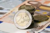 Some banknotes on five and fifty euros and coins — Stock Photo