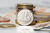 One ruble and the euro (coins and banknotes) — Stock Photo