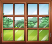 A closed window with a view of the green surroundings — Stock Vector