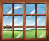 Een venster met een weergave van het vliegtuig in de lucht — Stockvector