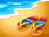 A pair of sandals at the beach — Stock Vector