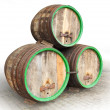Stock Photo: Three vintage beer barrels.