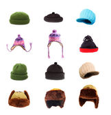 Great collection of warm headwear for winter weather. Fur-caps and homemade woolen knit hats. — Stock Photo