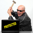Frustrated hacker and protected laptop — Stock Photo