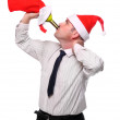 Drinking businessman with Santa's cap and stocking. New Year celebration concept — Stock Photo