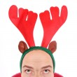 Crazy man with reindeer attire - head closeup. Funny image great for christmas and new year greeting card. — Stock Photo #29592067