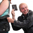 Stock Photo: Thief stealing from handbag of a woman. Insurance concept.