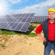 Engineer against solar panels. — Foto de Stock