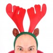 Crazy man with reindeer attire - head closeup. Funny image great for christmas and new year greeting card. — Stock Photo #29592193