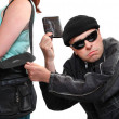 Stock Photo: Thief stealing from handbag of woman. Insurance concept.