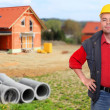 Building contractor and family house. — Stock Photo