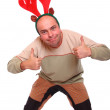 Happy young man with reindeer attire. Funny image great for christmas and new year greeting card. — Stock Photo #29592413