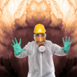 Worker in gas mask and chemical splash suit against a radioactive air pollution. Environmental hazard metaphor. — Stock Photo