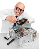Funny repairman with computer. Under construction concept — Stock Photo