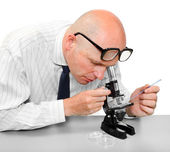 Male scientist with his microscope — Stock Photo
