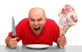 Angry hungry man (boss) with knife and raw bloody meat. Downsizing metaphor — Stock Photo