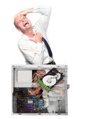 Angry businessman with his destroyed computer — Stock Photo