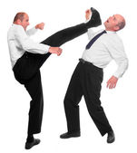 Angry manager kicking his rival. Funny picture from office — Stock Photo