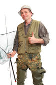The fisherman with fishing rod and landing net — Stock Photo