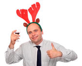 Drunken businessman with reindeer attire holding vine bottle. Funny image great for christmas and new year greeting card. — Stock Photo
