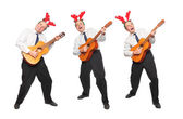 Crazy musicians in business suit with guitar singing. Christmas and new year party concept. — Stock Photo
