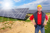 Engineer against solar panels. — Stock Photo