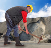 Working man with pick axe in a coal mine. Under construction concept. — Stock Photo