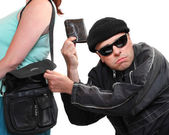 Thief stealing from handbag of a woman. Insurance concept. — Stock Photo