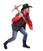Cowboy with pick axe on a white background. Under construction metaphor.. — Stock Photo