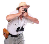 Photographer with camera dressed on suit for tropical destination — Stock Photo