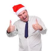 Happy businessman with Santa's cap. — Stock Photo