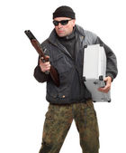 Dangerous gangster with shotgun and stolen money in suitcase. — Stock Photo