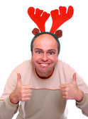 Happy young man with reindeer attire. Funny image great for christmas and new year greeting card — Stock Photo