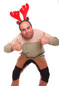 Happy young man with reindeer attire. Funny image great for christmas and new year greeting card. — Stock Photo