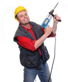 Drilling construction male worker on a white background. — Stock fotografie