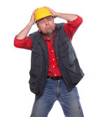 Male construction worker wearing a helmet isolated on a white background. — Stock Photo