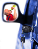 Drunken driver in rear mirror and key at car doors. Insurance metaphor. — Stock Photo