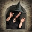 Scary witch rising from the vault. Halloween theme. — Stock Photo #32009625