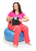 Overweight woman with weighing machine. — Stock Photo