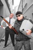 Gangster with shotgun and his victim — Stock Photo