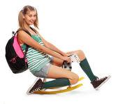 Funny schoolgirl riding back to school. — Stock Photo