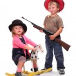 Boy and girl dressed in retro costume from American Old West. — Stock Photo